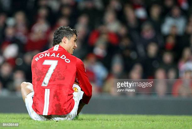 Cristiano Ronaldo of Manchester United lies injured during the FA Cup sponsored by eon Fourth Round match between Manchester United and Tottenham...