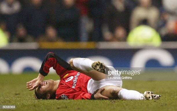 Cristiano Ronaldo of Manchester United lies injured on the pitch during the UEFA Champions League match between Manchester United and FC Porto at Old...