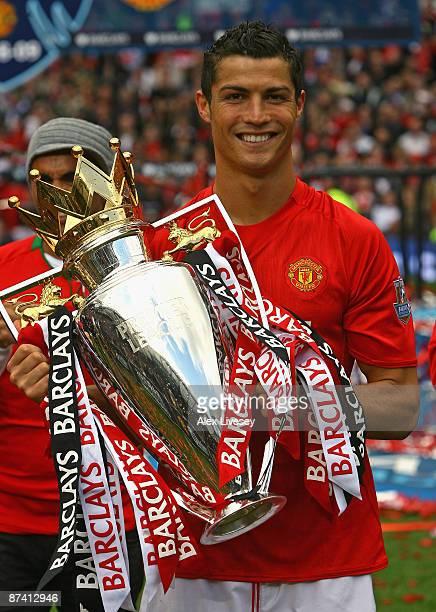 Cristiano Ronaldo of Manchester United lifts the Barclays Premier League trophy after the Barclays Premier League match between Manchester United and...