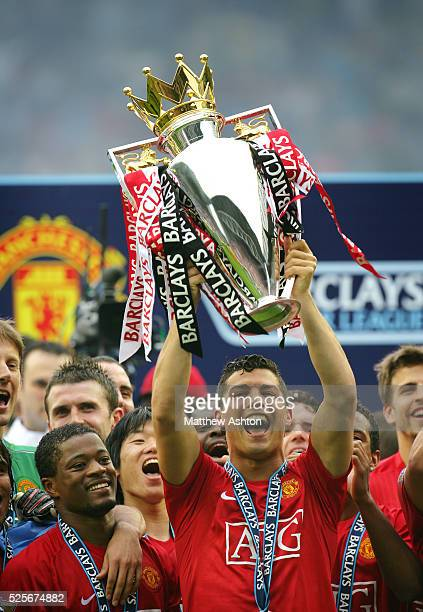 Cristiano Ronaldo of Manchester United lifts the FA Barclays Premier League trophy after winning the league season 2007-2008