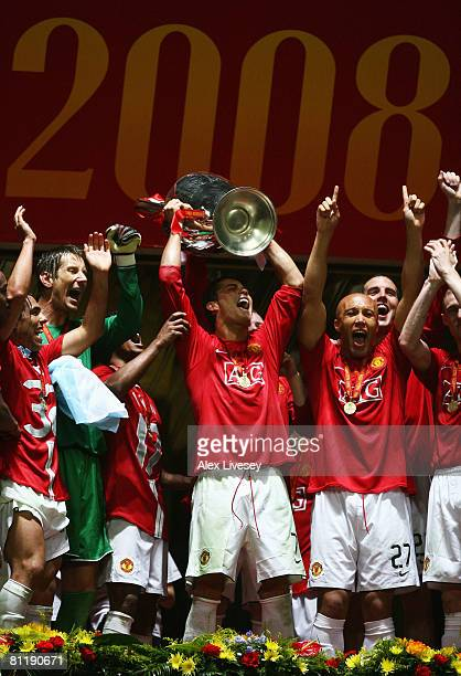 Cristiano Ronaldo of Manchester United lifts the trophy following his team's 65 victory in the penalty shootout during the UEFA Champions League...