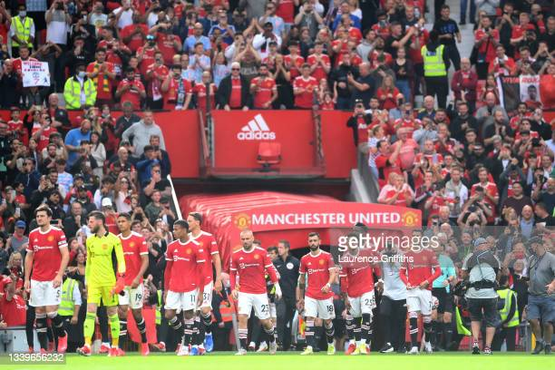 Cristiano Ronaldo of Manchester United makes his way on to the pitch with his team mates prior to the Premier League match between Manchester United...