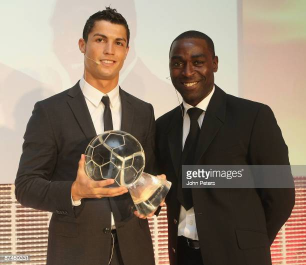 Cristiano Ronaldo of Manchester United poses with Andy Cole and the Goal of the Year Award at the club's annual Player of the Year awards at Old...