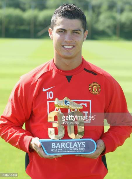 Cristiano Ronaldo of Manchester United poses with his Barclays 30 League Goals award at Carrington Training Ground on May 14 2008 in Manchester...
