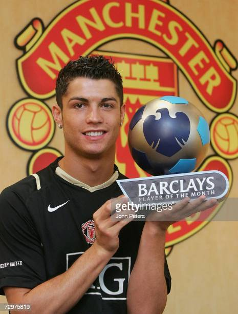 Cristiano Ronaldo of Manchester United poses with his Barclays Player of the Month award for December 2006 at Carrington Training Ground on January...