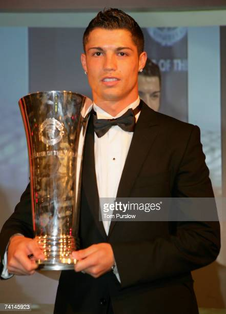 Cristiano Ronaldo of Manchester United poses with his Fans' Player of the Year award during the annual Manchester United Players' Player of the...