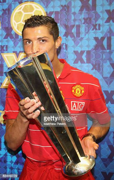 Cristiano Ronaldo of Manchester United poses with his FIFPRO World Player of the Year award at Carrington Training Ground on October 27 2008 in...