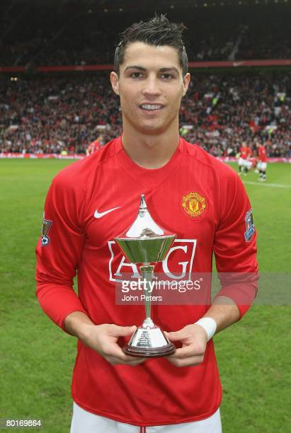 Cristiano Ronaldo of Manchester United poses with his PFA Fans' Player of the Month award ahead of the FA Cup sponsored by eon QuarterFinal match...