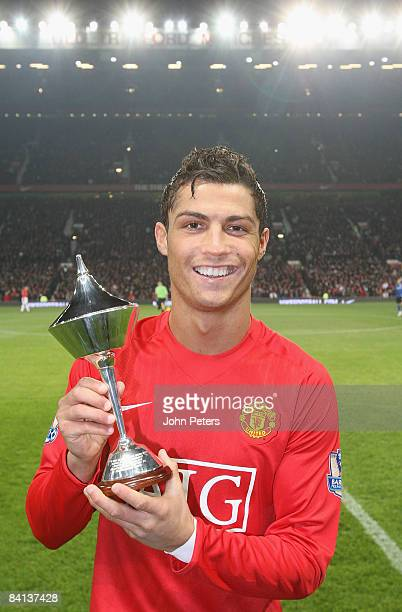 Cristiano Ronaldo of Manchester United poses with his PFA Player of the Month award for November ahead of the Barclays Premier League match between...