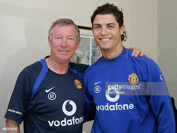 Cristiano Ronaldo of Manchester United poses with Sir Alex Ferguson after signing a two-year contract extension that will keep him at the club until...