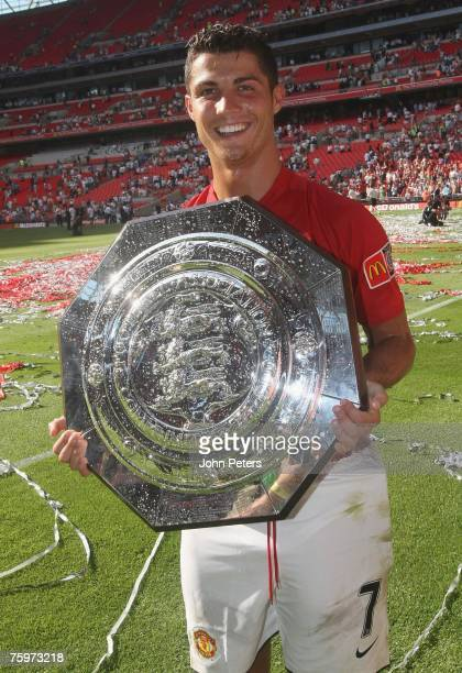 Cristiano Ronaldo of Manchester United poses with the Community Shield after winning the preseason friendly match between Chelsea and Manchester...