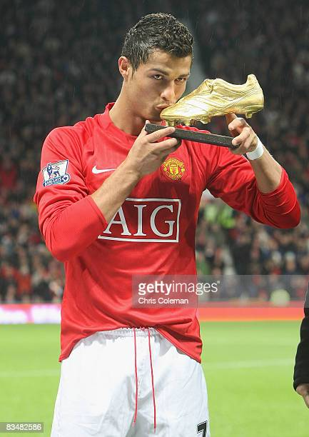 Cristiano Ronaldo of Manchester United poses with the European Golden Boot award as Europe's top scorer for the 2007 – 2008 season ahead of the...