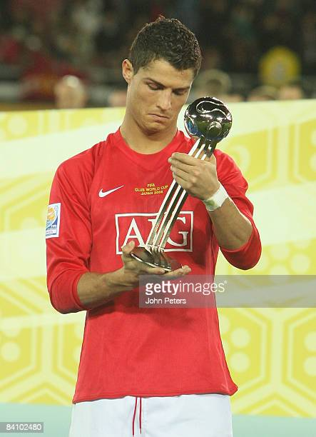 Cristiano Ronaldo of Manchester United poses with the Player of the Tournament award after the FIFA World Club Cup Final match between LDU Quito and...