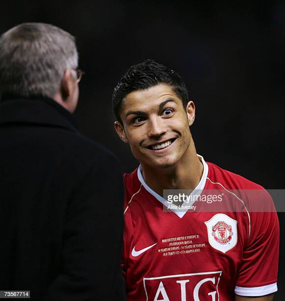 Cristiano Ronaldo of Manchester United pulls a face as he chats with Manchester United Manager Sir Alex Ferguson prior to the start of the UEFA...