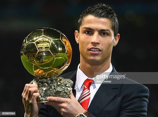 Cristiano Ronaldo of Manchester United receives the Ballon d'or after being voted the European Footballer of the Year before the UEFA Champions...
