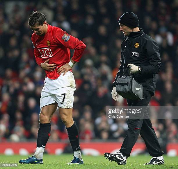 Cristiano Ronaldo of Manchester United receives treatment on an injury during the Barclays Premier League match between Manchester United and...