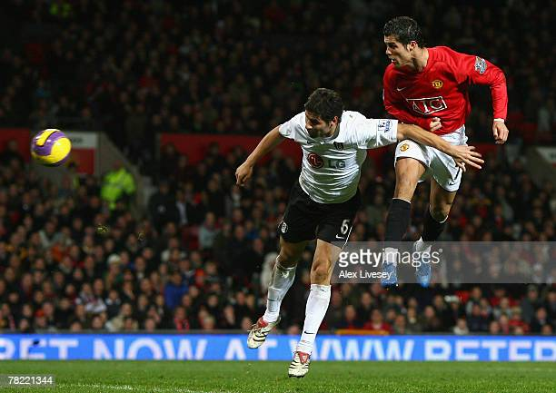 Cristiano Ronaldo of Manchester United rises above Dejan Stefanovic of Fulham to score his team's second goal during the Barclays Premier League...