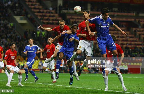 Cristiano Ronaldo of Manchester United rises highest to head the ball clear from the area during the UEFA Champions League Final match between...