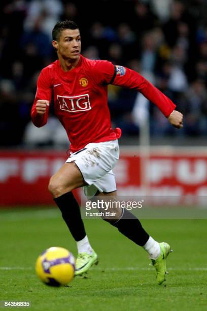 Cristiano Ronaldo of Manchester United runs for the ball during the Barclays Premier League match between Bolton Wanderers and Manchester United at...