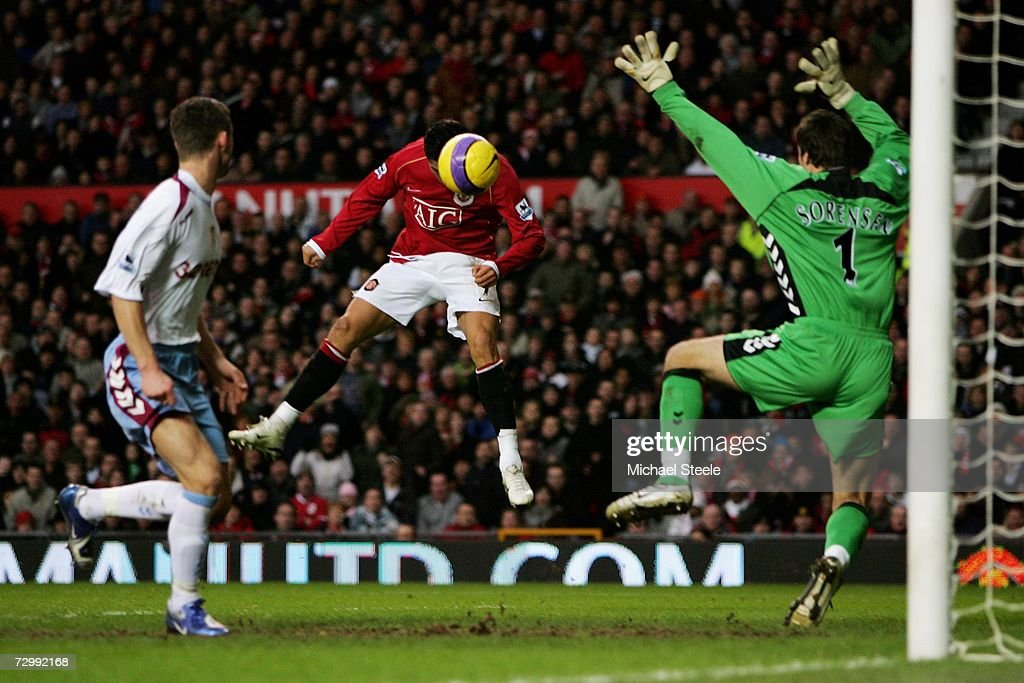 Cristiano Ronaldo of Manchester United scores a header past goalkeeper Thomas Sorensen of Aston Villa during the Barclays Premiership match between Manchester United and Aston Villa at Old Trafford on January 13, 2007 in Manchester, England.