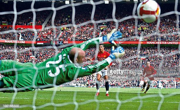 Cristiano Ronaldo of Manchester United scores a penalty past Pepe Reina of Liverpool during the Manchester United v Liverpool Premier League match at...
