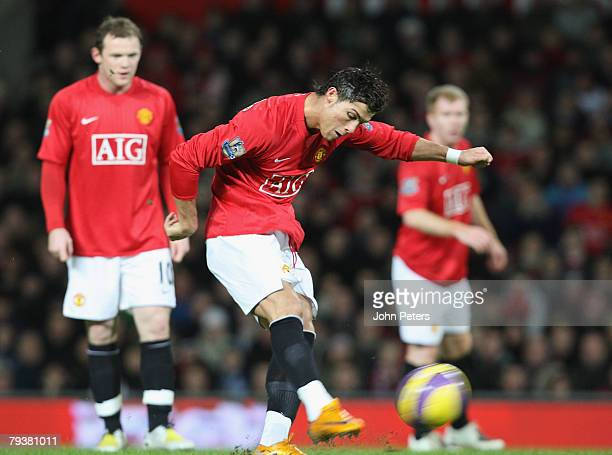 Cristiano Ronaldo of Manchester United scores his team's second goal during the Barclays FA Premier League match between Manchester United and...