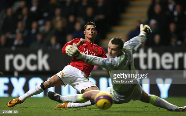 Cristiano Ronaldo of Manchester United scores his team's second goal during the Barclays Premier League match between Newcastle United and Manchester...