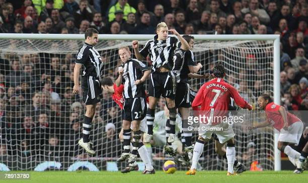 Cristiano Ronaldo of Manchester United scores their first goal during the Barclays FA Premier League match between Manchester United and Newcastle...