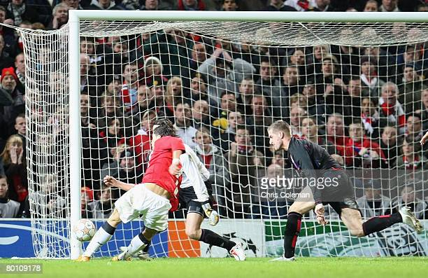 Cristiano Ronaldo of Manchester United scores their first goal during the UEFA Champions League first knockout round match between Manchester United...