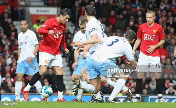 Cristiano Ronaldo of Manchester United scores their first goal during the Barclays FA Premier League match between Manchester United and Aston Villa...