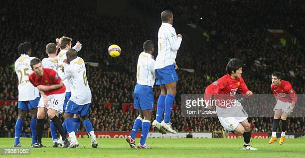 Cristiano Ronaldo of Manchester United scores their second goal during the Barclays FA Premier League match between Manchester United and Portsmouth...