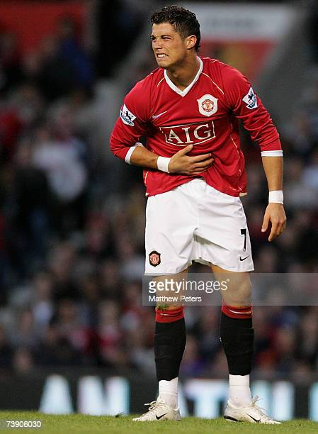 Cristiano Ronaldo of Manchester United shows his pain at a stomach injury during the Barclays Premiership match between Manchester United and...