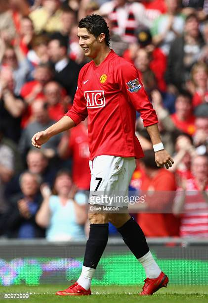 Cristiano Ronaldo of Manchester United smirks after scoring his team's second goal during the Barclays Premier League match between Manchester United...