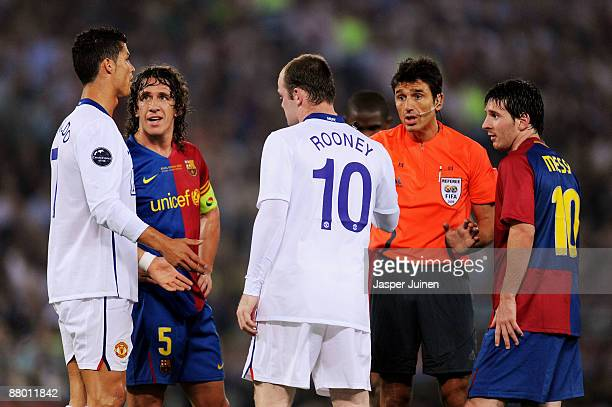 Cristiano Ronaldo of Manchester United speaks to referee Massimo Busacca during the UEFA Champions League Final match between Barcelona and...