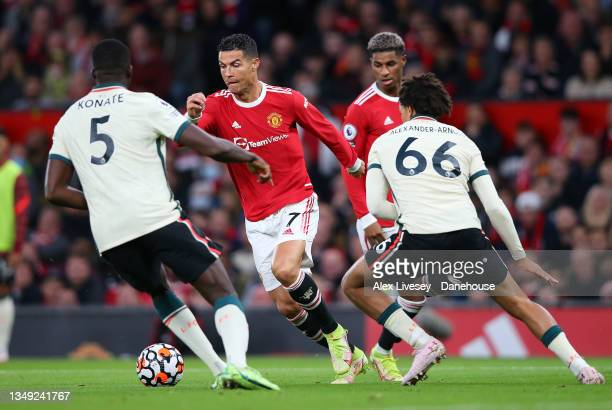 Cristiano Ronaldo of Manchester United takes on Trent Alexander-Arnold of Liverpool during the Premier League match between Manchester United and...