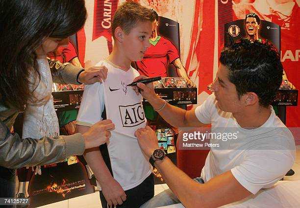 Cristiano Ronaldo of Manchester United takes part in a signing session in the Megastore at Old Trafford on May 11 2007 in Manchester England