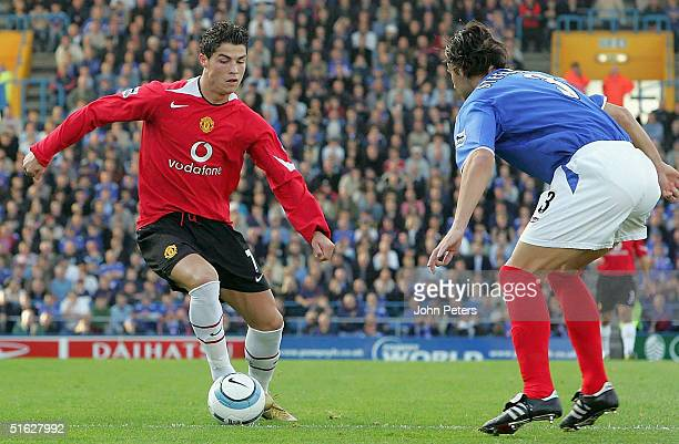 Cristiano Ronaldo of Manchester United takes the ball between David Unsworth and Dejan Stefanovic of Portsmouth during the Barclays Premiership match...