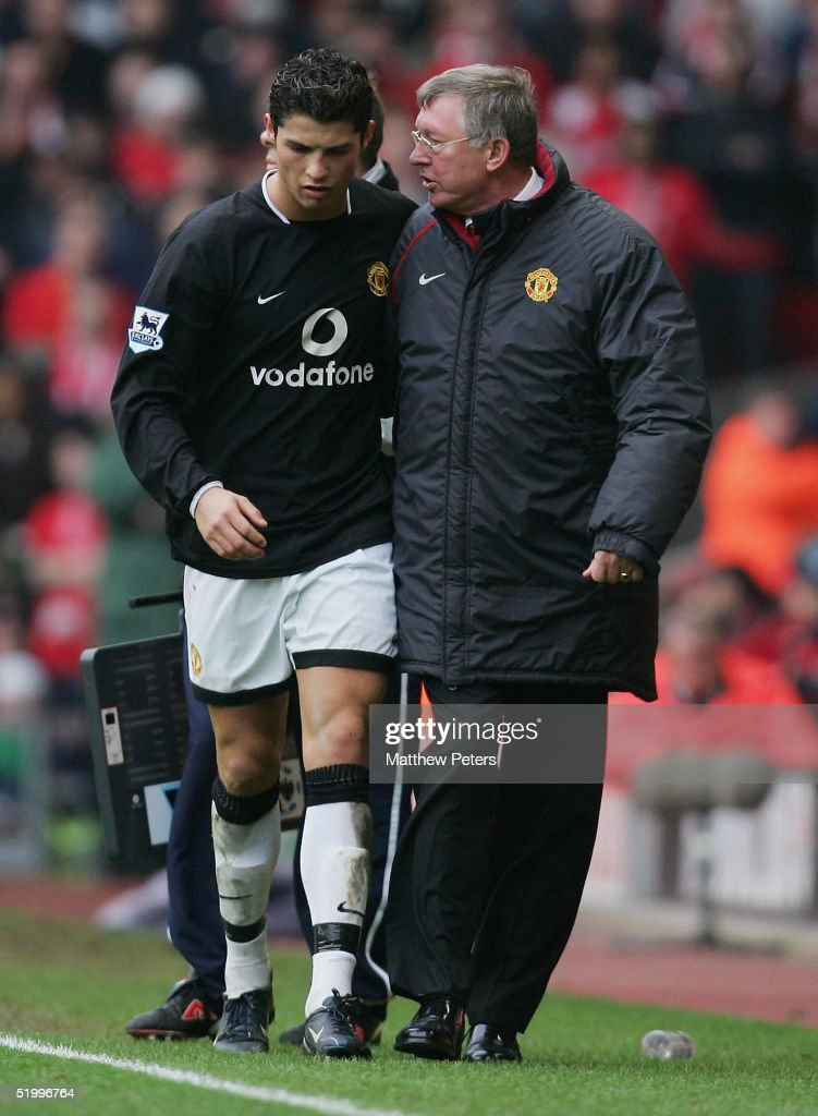 Cristiano Ronaldo of Manchester United talks to Sir Alex Ferguson after being substituted during the Barclays Premiership match between Liverpool and Manchester United at Anfield on January 15 2005 in Liverpool, England.