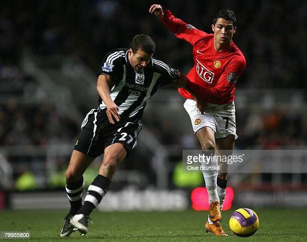 Cristiano Ronaldo of Manchester United tangles with Steven Taylor of Newcastle United during the Barclays Premier League match between Newcastle...