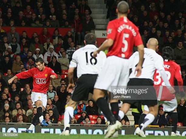 Cristiano Ronaldo of Manchester Unted scores their first goal during the Barclays FA Premier League match between Manchester United and Fulham at Old...