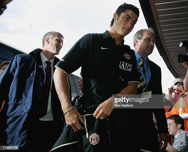 Cristiano Ronaldo of Manchester Utd leaves the team bus to walk into the Kassam Stadium for the pre season friendly match between Oxford Utd and...