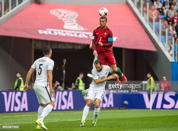 Cristiano Ronaldo of Portugal and Andrew Durante of New Zealand head the ball during the FIFA Confederations Cup Group A match between New Zealand...