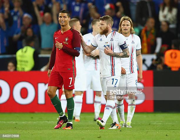 Cristiano Ronaldo of Portugal and Aron Gunnarsson of Iceland in discussion after the UEFA EURO 2016 Group F match between Portugal and Iceland at...