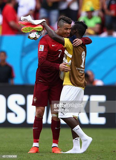 Cristiano Ronaldo of Portugal and Daniel Opare of Ghana hug after the 2014 FIFA World Cup Brazil Group G match between Portugal and Ghana at Estadio...