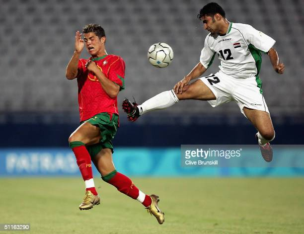 Cristiano Ronaldo of Portugal and Haidar Abdul Razzaq of Iraq compete in the men's football preliminary match between Iraq and Portugal during the...