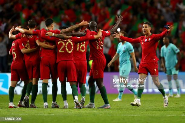 Cristiano Ronaldo of Portugal and his team celebrate the final whistle victory and winning the UEFA Nations League Final between Portugal and the...