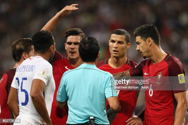 Cristiano Ronaldo of Portugal and his teammates protest to referee Alireza Faghani during the FIFA Confederations Cup Russia 2017 SemiFinal match...