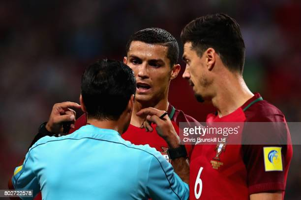Cristiano Ronaldo of Portugal and Jose Fonte of Portugal complain to referee Alireza Faghani during the FIFA Confederations Cup Russia 2017 SemiFinal...