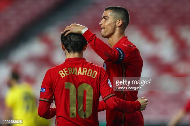 Cristiano Ronaldo of Portugal and Juventus celebrates scoring Portugal Seven goal with Bernardo Silva of Portugal and Manchester City during the...