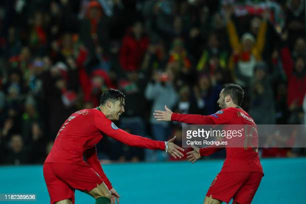 Cristiano Ronaldo of Portugal and Juventus celebrates scoring Portugal sixth goal with Bernardo Silva of Portugal and Manchester City during the UEFA...